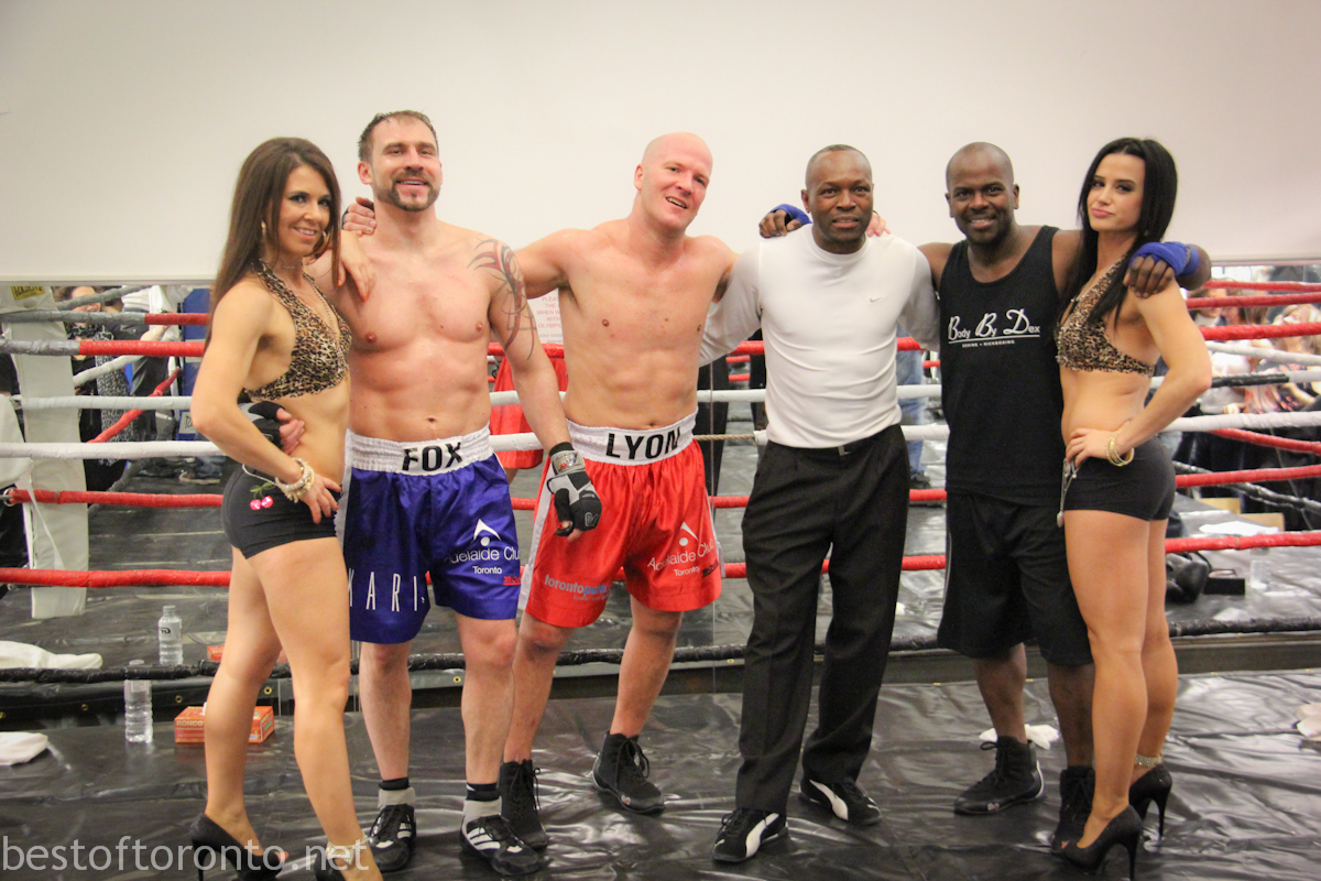 Nigel Fox, Blair Lyon, and boxing trainer Dexter Delves (in black), after their fight at Adelaide Club's 3rd annual Rumble