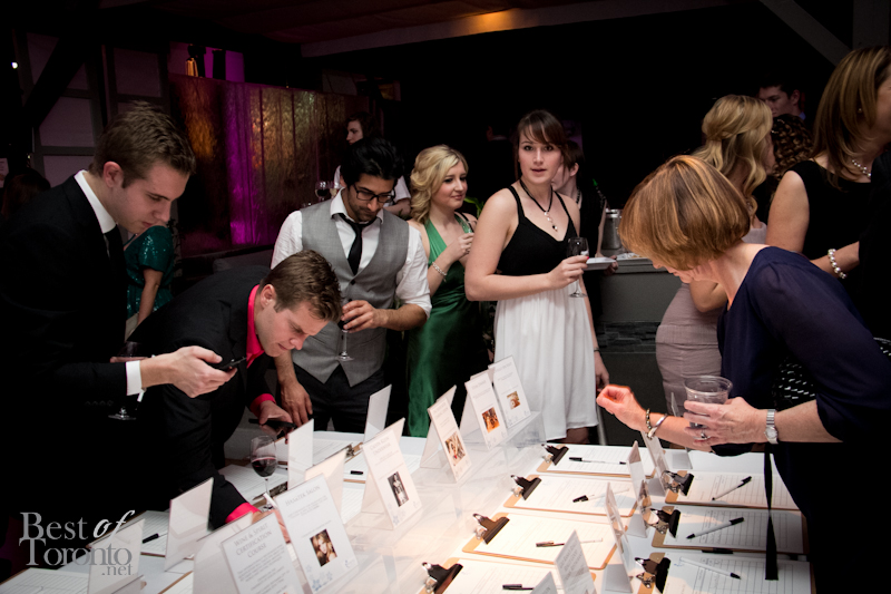 Guests bidding on the silent auction