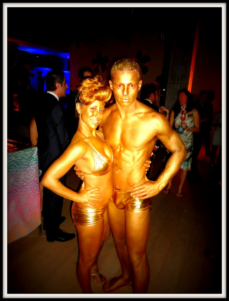 Models covered in gold