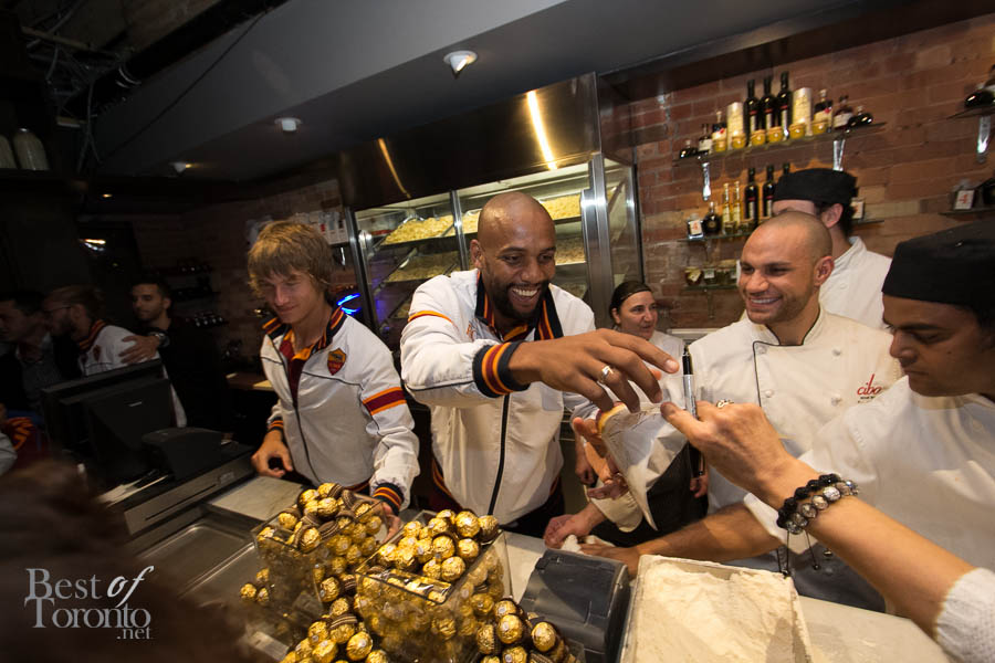 AS Roma players handing out Ferrero Roche chocolate and nutella to guests