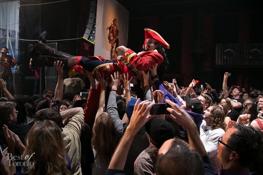A crowd surfing Captain Morgan