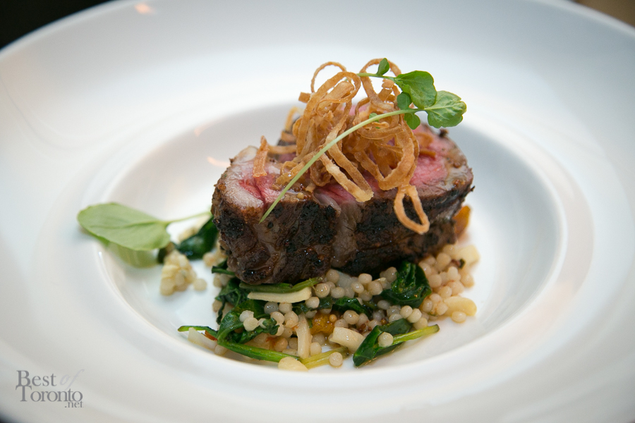 Centre cut striploin, with Israeli couscous, baby spinach, blistered tomatoes, hearts of palm and triple mustard vinaigrette
