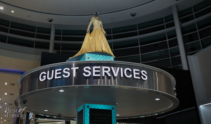 Lucian Matis created this exclusive golden anniversary evening gown to commemorate Yorkdale's 50th. It is displayed on top of Yorkdale's Guest Services.