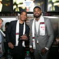 DeMar DeRozan, Amir Johnson of the Toronto Raptors serving drinks at Real Sports Bar