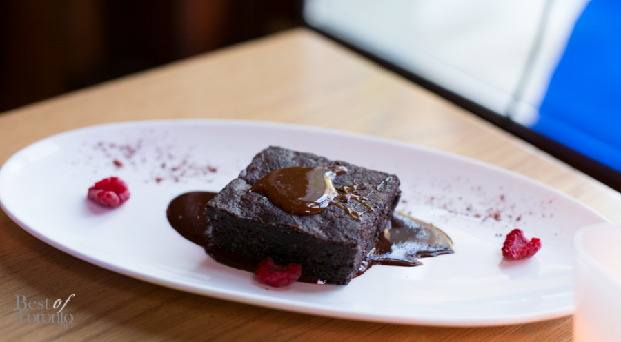 """Mexican Chocolate Fudge Brownie"" with guajillo chili and salted caramel sauce. Vegan-friendly."