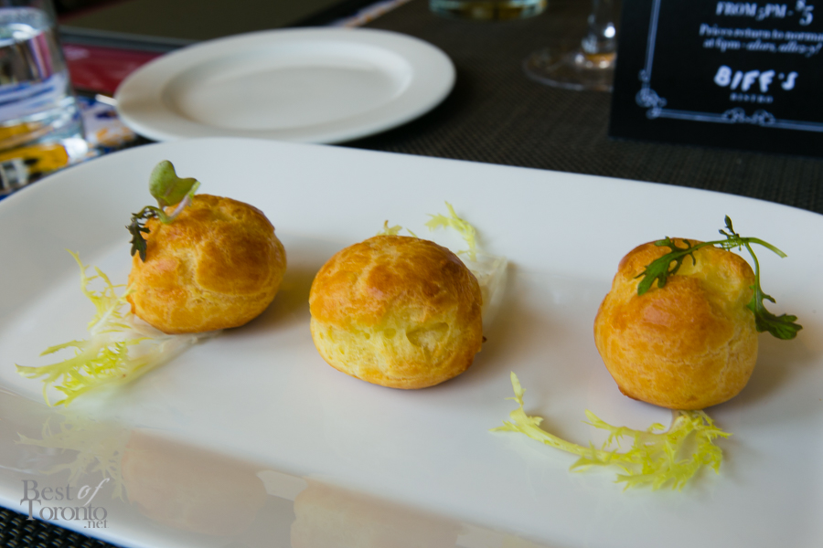 Gougère - a choux pastry filled with goat cheese mousse infused with herb garlic and lemon | Photo: Nick Lee