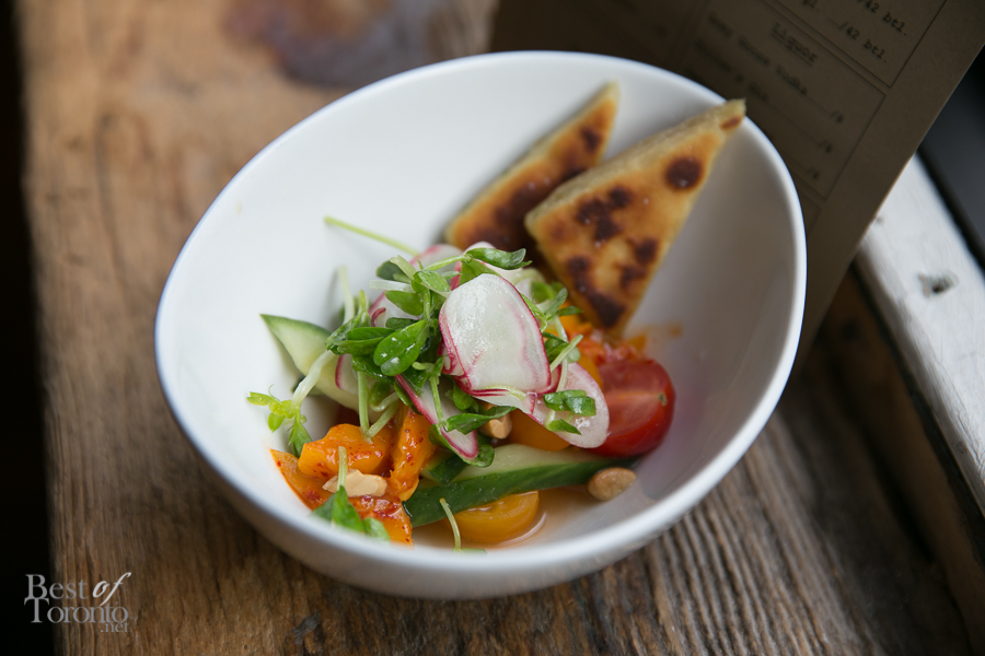 """'Tastes' of Heirloom Tomato"" with Lemongrass-tomato water, mango Kim Chi, pickled cucumber, radish, cashew, scallion pancake"