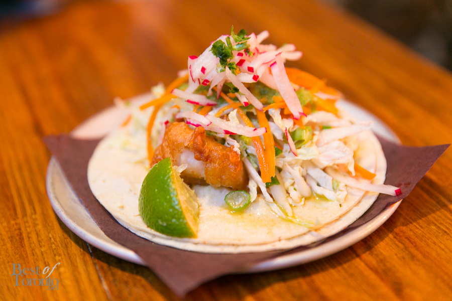 Baja Fish Taco with a choice of fried or grilled baja fish topped with guajillo-ponzu tartar sauce and napa cabbage slaw in a soft shell | Photo: Nick Lee