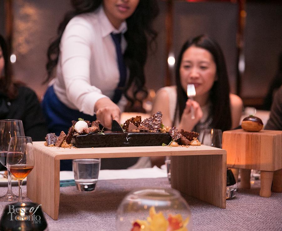 Valrhona Chocolate Cake, Caramel Chocolate Ganache, Aerated Milk Chocolate, Hazelnut Praline Pastry Cream, Cacao Nib Tuile And Sweet Milk Sorbet | Photo: Nick Lee