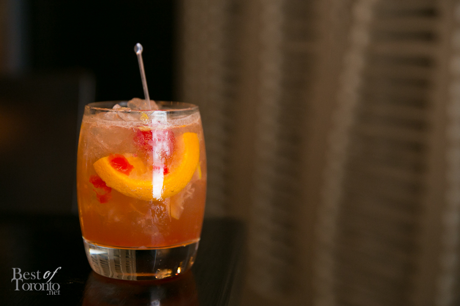 "The Keg's take on the ""Old Fashioned"" Woodford Reserve bourbon, bitters, lemon, orange, sugar and soda."