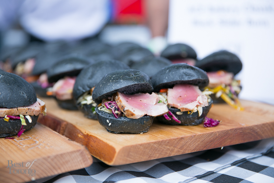 Seared ahi tuna with asian slaw on black slider buns by Ace Bakery