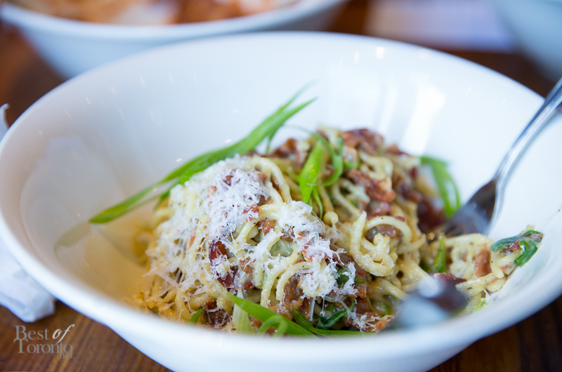 Carbonara pasta with smoked bacon, cracked black pepper, egg, scallion, grana padano