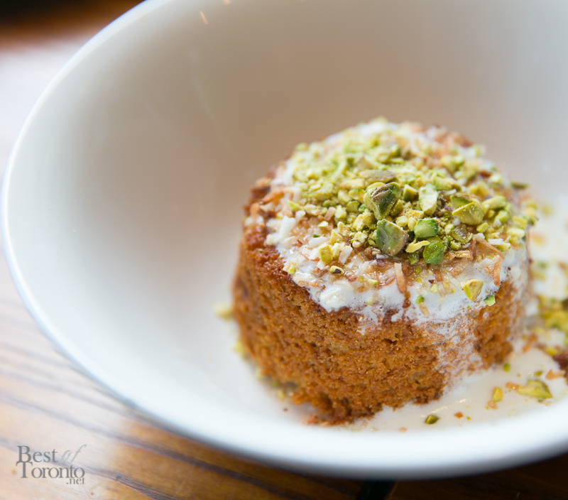 Warm Brown Butter and Coconut Semolina Cake with coconut icing, toasted pistachio