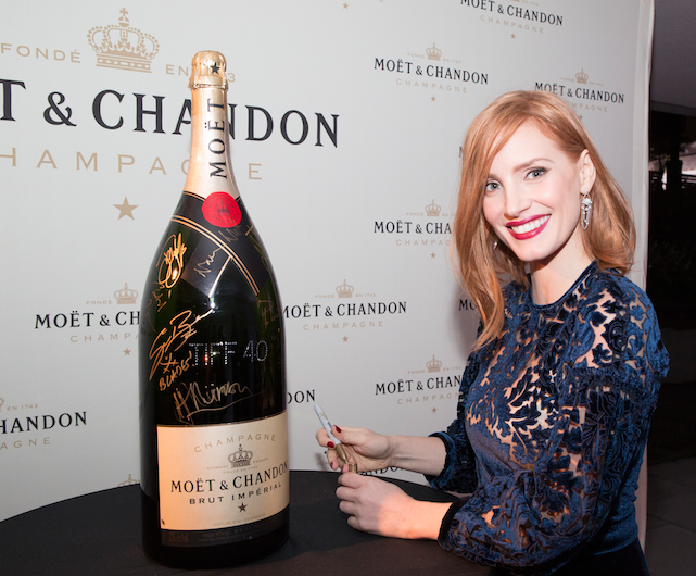 Actor, Jessica Chastain in Toronto for the world premiere of The Martian signs the Moët & Chandon charity bottle on the red carpet at Roy Thomson Hall. The bottle will be auctioned off at the end of the festival with all proceeds going to support TIFF's charitable initiatives. | Photo courtesy of Moet & Chandon