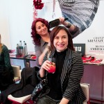 Sari Colt enjoying a cocktail while getting her hair did