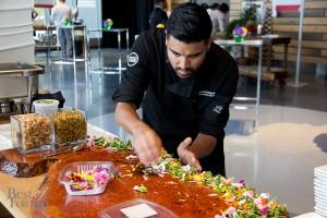 Devan Rajkumar, Executive Chef, Food Dudes preparing chicken drummettes