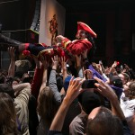 A crowd surfing Captain Morgan