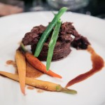 beef pastry with pure Caribbean chocolate, maple glazed baby carrots and asparagus