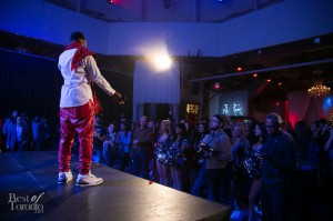 Kardinal Offishall speaking on stage