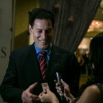 TVO's Steve Paikin (Paikin and the Premiers) showing his library card to Melanie Ng (City)