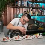 "Co-owner Lester Sabilano serving up ""Krispy Pata"" dishes"