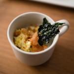 """Arroz Caldo"" is Filipino rice porridge with chicken, garlic, chicharron and kale. Really delicious."