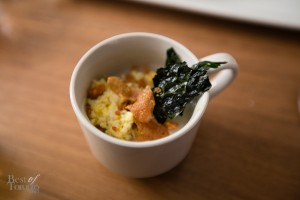 """Arroz Caldo"" is Filipino rice porridge with chicken, garlic, chicharron and kale. Really delicious."