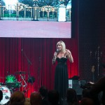 Host Carla Collins on stage
