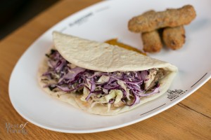 """""""The Jerk"""" with spicy pulled jerk chicken and slaw in a soft house-made coco bread pocket. On the side there's rice and pea fritters and a delicious mango chutney dip"""
