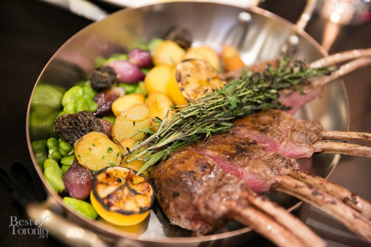 Whole roasted Ontario rack of lamb with morels, fava beans, onions, potato, yogurt and mint.