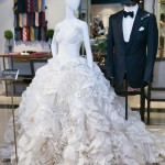 "Kleinfeld's ""Pinnacle Tornai"" wedding gown displayed beside a Garrison Bespoke wedding suit 