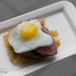 Quail eggs and steak on house made kettle chips