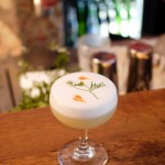 The Karate Kid II is a cocktail of nigori sake, jasmine tea-infused gin, yuzu and lime juice, vanilla syrup, egg white, and coriander.