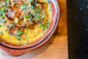 Pecorino herb polenta with acorn squash, tomatoes and carrots