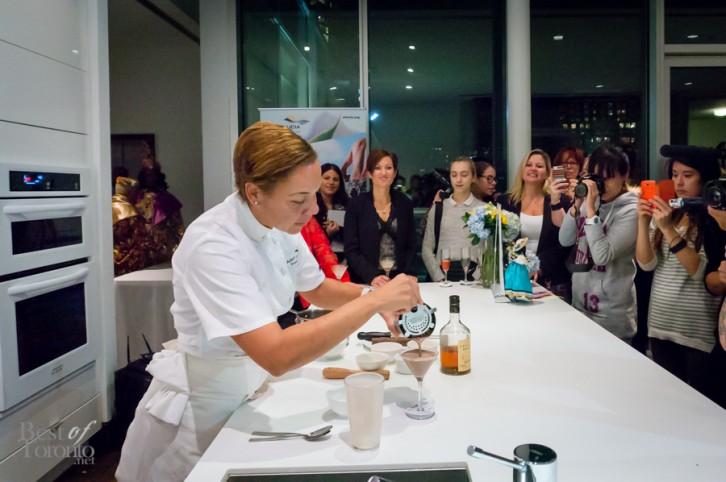 Chef Nina Compton finishing the Cocoa Tea Martini