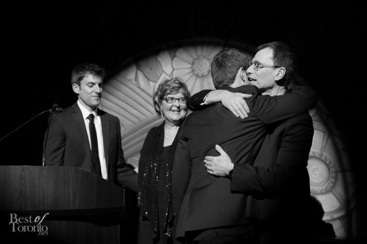 Adam Panov hugging his father, Yaron Panov after a heartfelt speech.