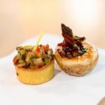 Fine ratatouille in corn bread cup topped with micro basil, Baked mini potato chockfull of 3 year old cheddar, double smoked bacon & chives