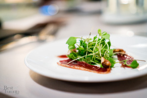 Baby arugula salad with duck prosciutto, candied walnuts & empire apple cider dressing