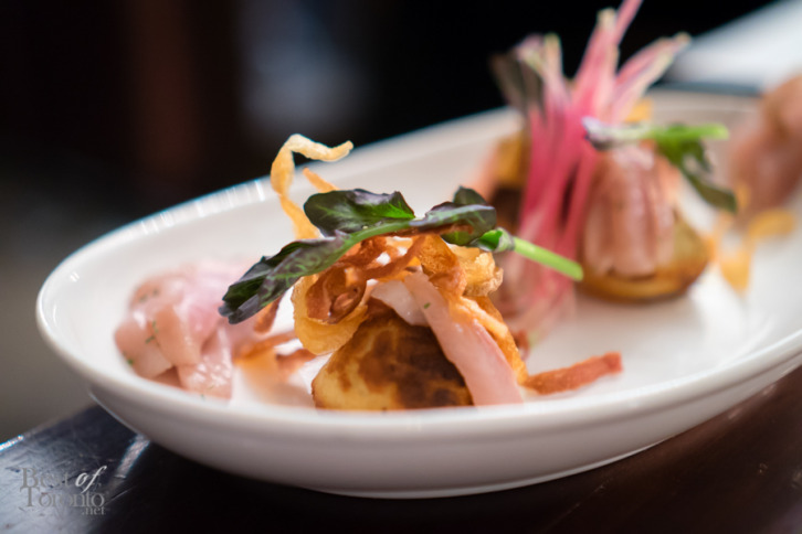 Honey and potato rye ebelskiver, spruce cured trout, crème fraiche, potato petals