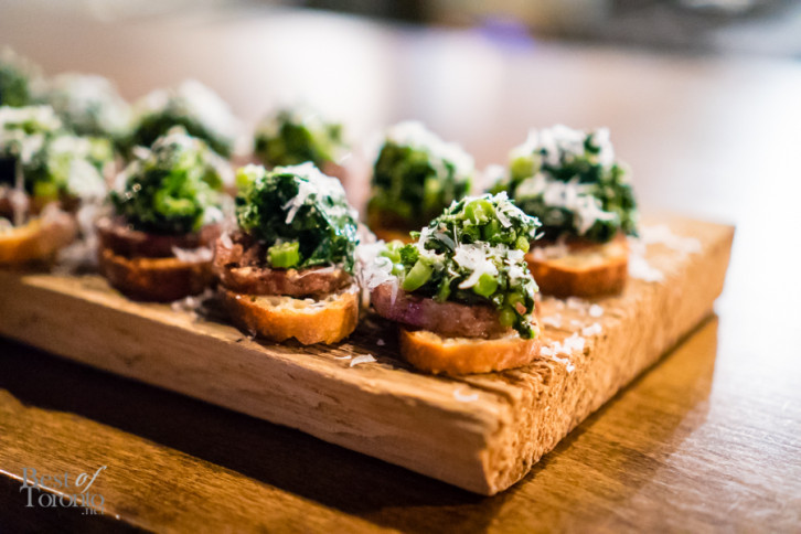 Cotechino and rapini on crostini