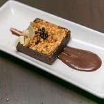 """Chocolate Peanut Butter Tart"" with candied peanut bark and dark chocolate ganache"