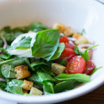 Panzanella with grape tomato, Fior de latte, shaved red onion, house-baked focaccia crouton, baby spinach, fresh basil