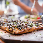 Funghi pizza with portobello, oyster, and cremini mushrooms and mascarpone, roasted garlic crema