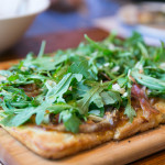 Smoked Proscuitto with speck, sweet medjool date sauce, fresh arugula, Fior de Latte, toasted almond