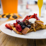 Cinnamon brioche french toast with seasonal fruit, chantilly, candied pecans, local syrup